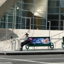 a man waiting in front of WDMH